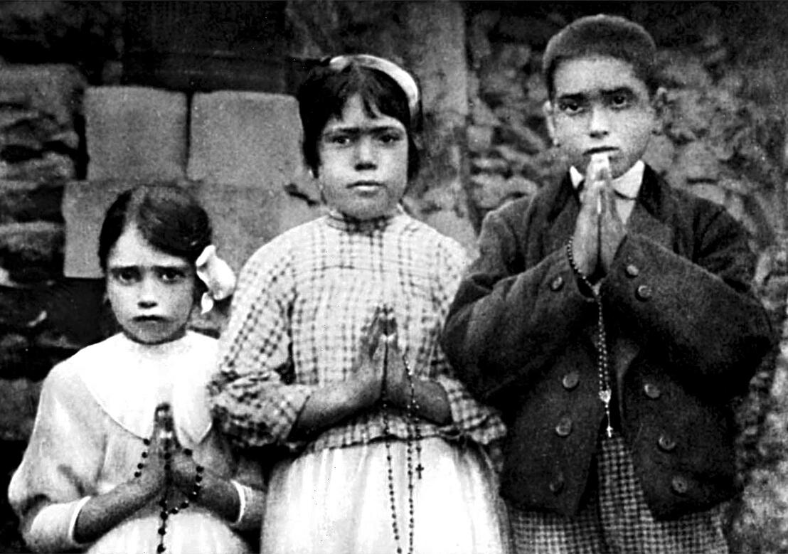 Portuguese shepherd children Lucia dos Santos, center, and her cousins, Jacinta and Francisco Marto, are seen in a file photo taken around the time of the 1917 apparitions of Mary at Fatima. (CNS photo/EPA)