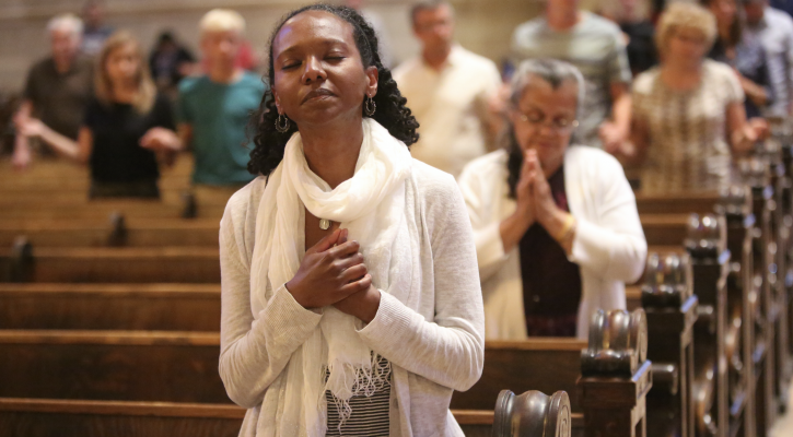 A woman prays at the Cathedral of St. Paul in Minnesota July 8. Pope Francis said Oct. 20 that prayer, silent adoration and recognizing one's sinfulness are needed to grasp the mystery of Christ and the immensity of his love. (CNS photo/Dave Hrbacek, The Catholic Spirit)